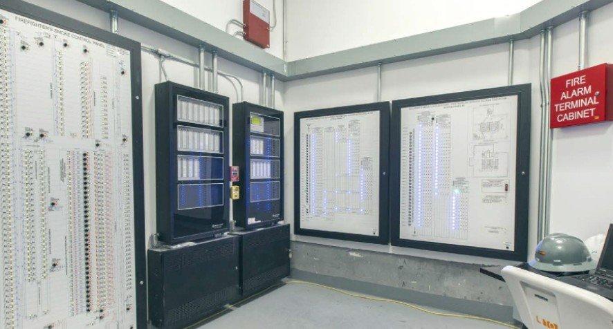 Control room with Occupant Evacuation Elevator status panels.